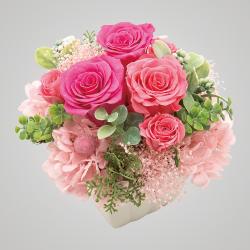 スタイル:華やか 色味:ピンク系 バラ・あじさい・かすみ草・フェイクグリーンの可愛らしい雰囲気のイメージ。 5,000円